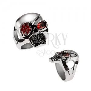 Masívny oceľový prsteň, lebka s páskou cez oko, červené zirkóny