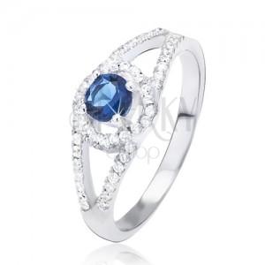 Prsteň zo striebra 925, rozdvojené zirkónové ramená, modrý kamienok v kruhu