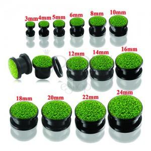 Čierny okrúhly tunel plug do ucha so zelenými trblietkami