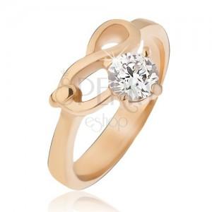 Oceľový prsteň zlatej farby, symbol nekonečna a číry zirkón