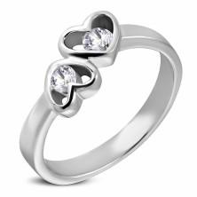 Oceľový prsteň striebornej farby, dve srdcia s čírymi zirkónmi