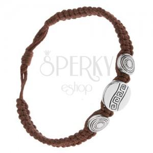 Náramok z čokoládovohnedých šnúrok, tri známky, grécky kľúč a kruhy