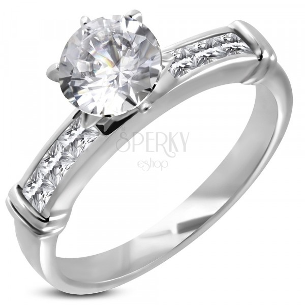 Zásnubný prsteň s veľkým vsadeným zirkónom, línia zirkónov v hranatej prednej časti