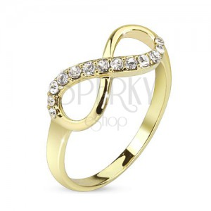 Prsteň zlatej farby, symbol nekonečna zdobený čírymi zirkónmi