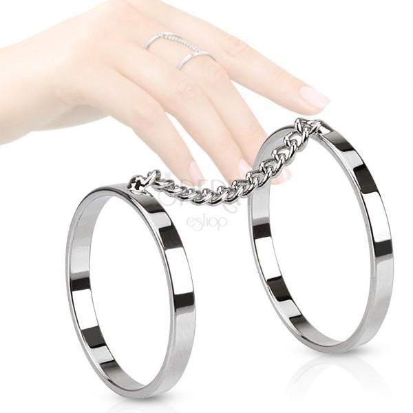 Dvojitý prsteň z ocele, ródiované obrúčky spojené retiazkou