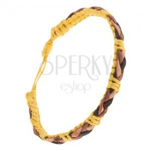 Žltý šnúrkový náramok, hnedo-čierny kožený vrkoč na povrchu