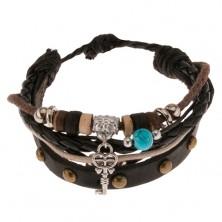 Multináramok - čierny vybíjaný pás kože, šnúrky, korálky a valčeky, ozdobný kľúč