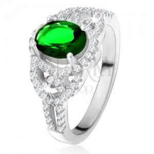 Prsteň - oválny zelený zirkón, lem, zaoblené línie, číre kamienky, striebro 925