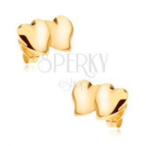 Náušnice zo žltého 9K zlata - dve prekrývajúce sa asymetrické srdcia