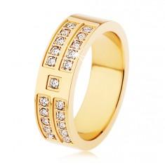 Oceľový prsteň zlatej farby, ozdobné línie a štvorčeky čírych zirkónov
