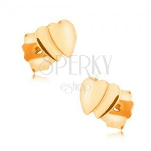 Náušnice v žltom 9K zlate - dve malé prekrývajúce sa súmerné srdiečka