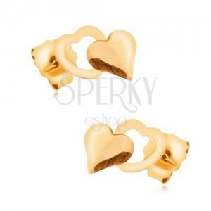 Zlaté náušnice 375 - lesklé pravidelné plné srdce prekrývajúce obrys srdiečka