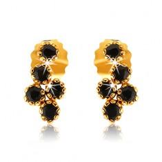 Šperky eshop - Puzetové náušnice v žltom 9K zlate, strapec z okrúhlych zafírov čiernej farby GG54.03