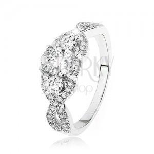 Žiarivý strieborný prsteň 925, prekrížené zvlnené ramená, oválny zirkón