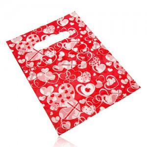 Darčekové igelitové vrecúško, srdiečková potlač na červenom podklade