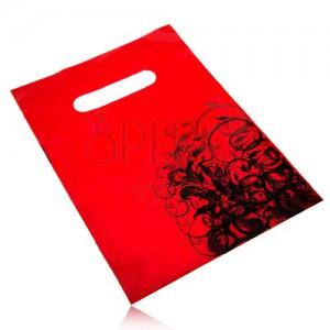 Igelitová ozdobná taštička červenej farby, čierne kvetinové ornamenty