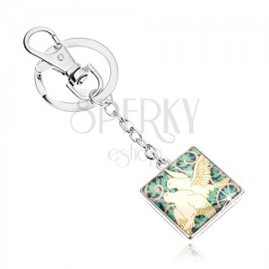 Kľúčenka v štýle cabochon, štvorec s čírou glazúrou, dve biele holubice, lístky