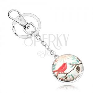 Cabochon kľúčenka, kruh so sklom, červený vtáčik na konári s lístkami, kvety