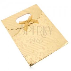 Darčeková taštička z papiera, lesklý povrch zlatej farby, srdiečka, špirály, pásiky