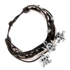 Šperky eshop - Čierno-biely pletený náramok, oceľové guličky a prívesky - lebky s kosťami SP79.29