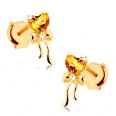 0d71b4317 Šperky eshop - Náušnice zo žltého 14K zlata - citrínové srdiečko žltej  farby, lesklá mašlička