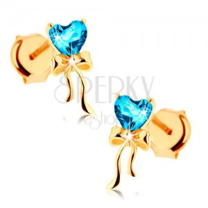 Zlaté náušnice 585 - lesklá mašlička, modré topásové srdiečko