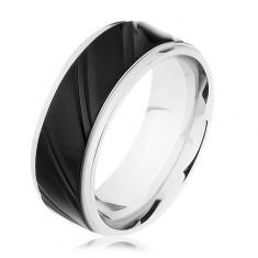 Oceľový prsteň striebornej farby s čiernym pásom, šikmé zárezy