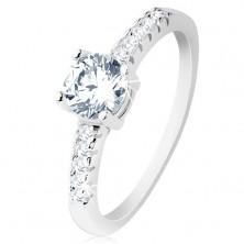 Zásnubný prsteň, striebro 925, ramená vykladané zirkónmi, okrúhly číry zirkón