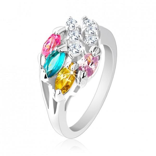 Lesklý prsteň striebornej farby, farebné zirkónové zrnká, číre zirkóniky