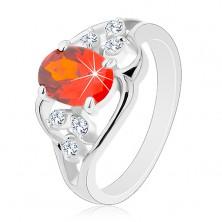 Prsteň v striebornom odtieni, oranžový oválny zirkón, zvlnené línie