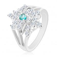 Prsteň v striebornom odtieni, rozvetvené ramená, číry kvet, svetlomodrý zirkón