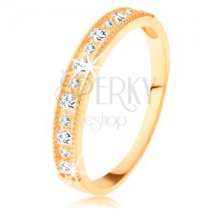 Ligotavý prsteň v žltom 14K zlate - línia čírych zirkónov s vrúbkovaným lemom