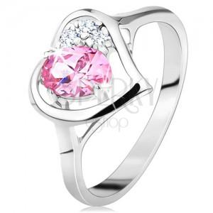 Prsteň striebornej farby, obrys srdiečka s ružovým oválom a čírymi zirkónikmi