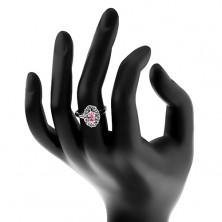 Ligotavý prsteň s ružovým brúseným zrnkom, oválny lem z čírych zirkónikov