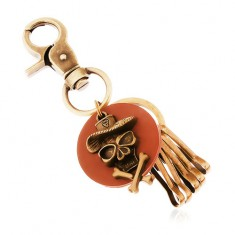 Prívesok na kľúče v mosadznom odtieni, hnedý kruh, lebka v klobúku