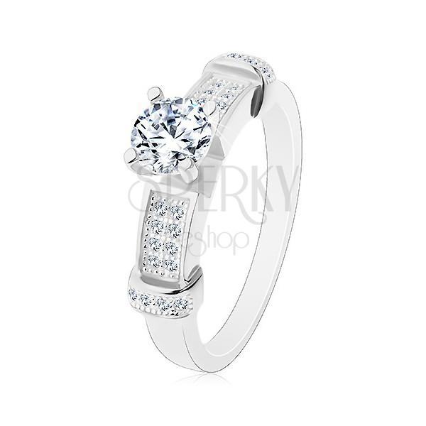 Strieborný prsteň 925, okrúhly zirkón čírej farby, dekoratívne ramená