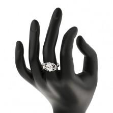 Prsteň v striebornom odtieni, úzke oblúky, farebný oválny zirkón