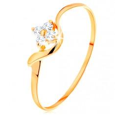 Prsteň zo žltého 14K zlata - číry zirkónový kvietok, zvlnené rameno