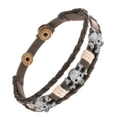 Šperky eshop - Nastaviteľný kožený náramok, oceľové lebky s kosťami, béžové šnúrky Y47.01