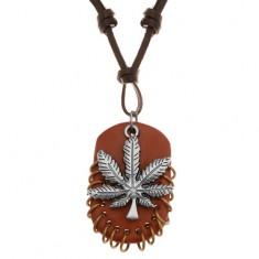 Šperky eshop - Náhrdelník z umelej kože, prívesky - list marihuany a hnedý ovál s krúžkami Z22.17