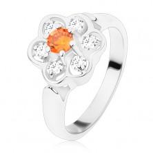 Prsteň v striebornom odtieni, ligotavý číry kvietok s oranžovým stredom