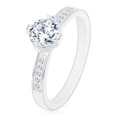 Strieborný prsteň 925, zirkón čírej farby v ozdobnom kotlíku, zirkóniky na ramenách