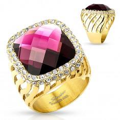 Mohutný oceľový prsteň zlatej farby, veľký fialový zirkón s čírou obrubou, výrezy
