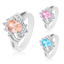 Ligotavý prsteň striebornej farby, veľký farebný ovál, tenké oblúky a číre zirkóny