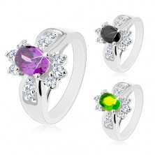 Lesklý prsteň s rozšírenými ramenami, farebný oválny zirkón, okrúhle číre zirkóniky