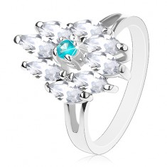 Prsteň striebornej farby, akvamarínovo modrý stred a číre zrnká
