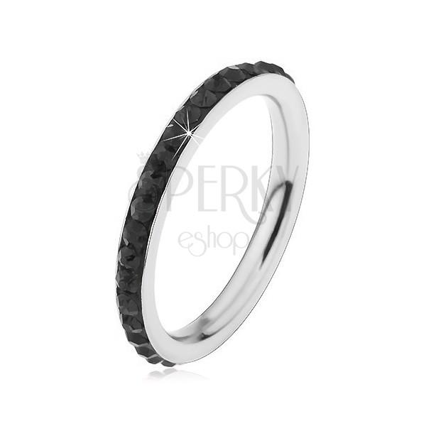 Oceľový prsteň striebornej farby, ligotavé čierne zirkóniky