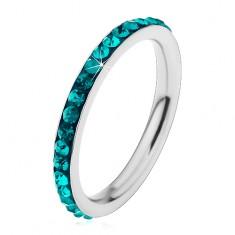 Oceľový prsteň striebornej farby, ligotavé zirkóniky v akvamarínovom odtieni