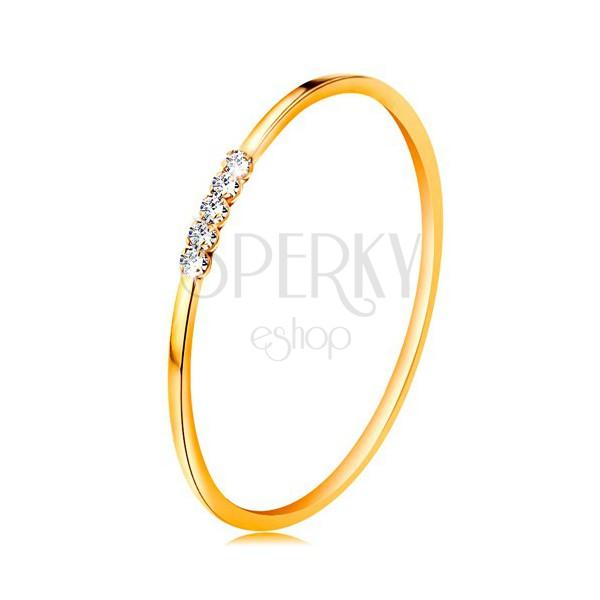 Prsteň v žltom 14K zlate - línia čírych zirkónikov, tenké lesklé ramená