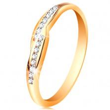 Prsteň v žltom 14K zlate, rozšírené konce ramien so vsadenými zirkónmi